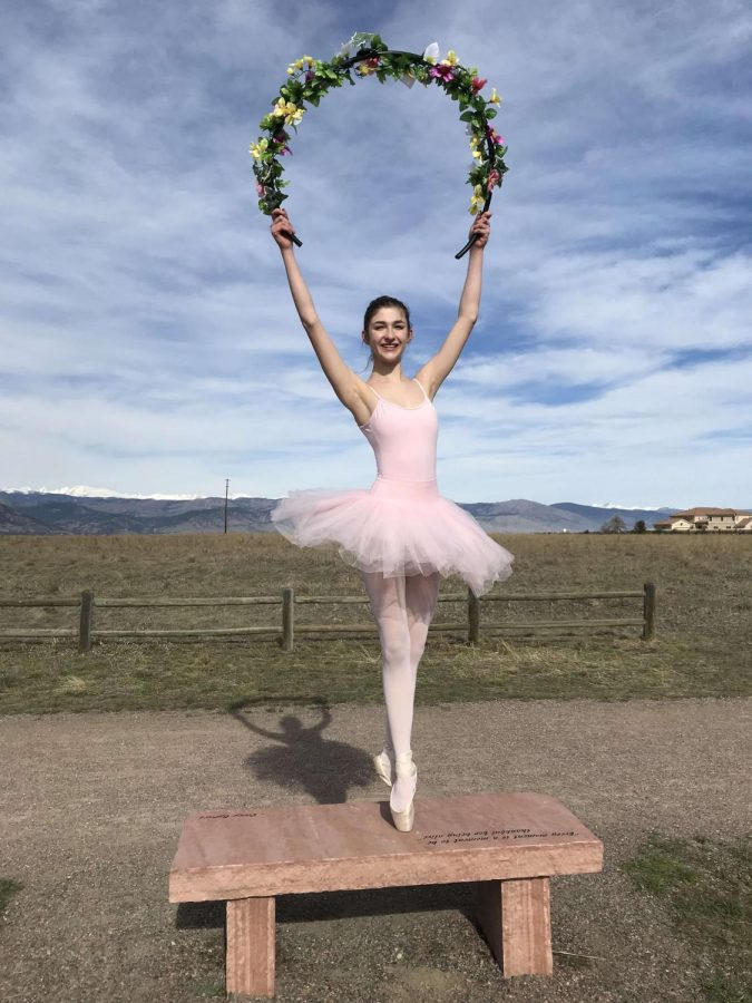 Amy Hood in her ballet leotard holding up some gorgeous flowers
