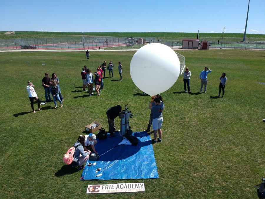 Erie+Aerospace+students+fill+the+weather+balloon+with+helium+just+prior+to+its+maiden+flight.