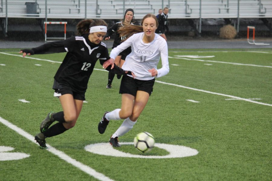 Senior Adlee Schenbeck chases after a Berthoud player
