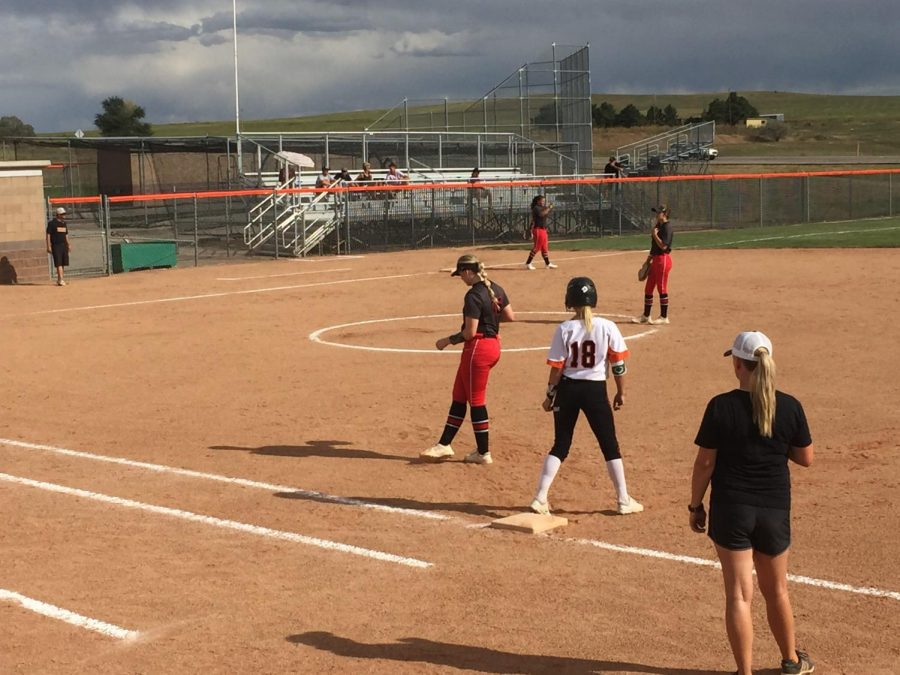 Teagan Brand stands on first base after one of her hits on the afternoon