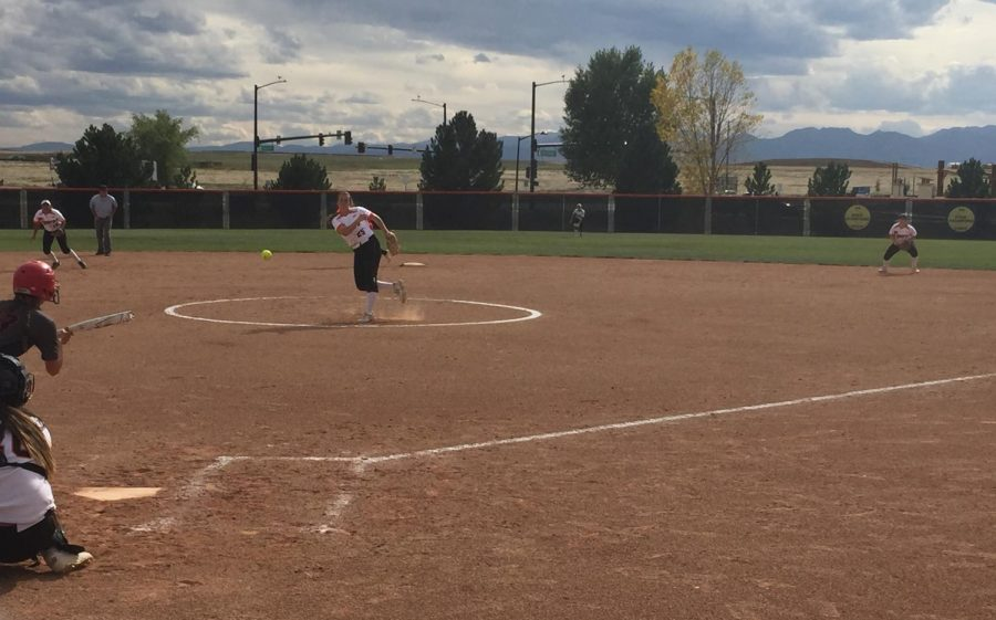 Madie Leach delivers a pitch to the Mustang batter