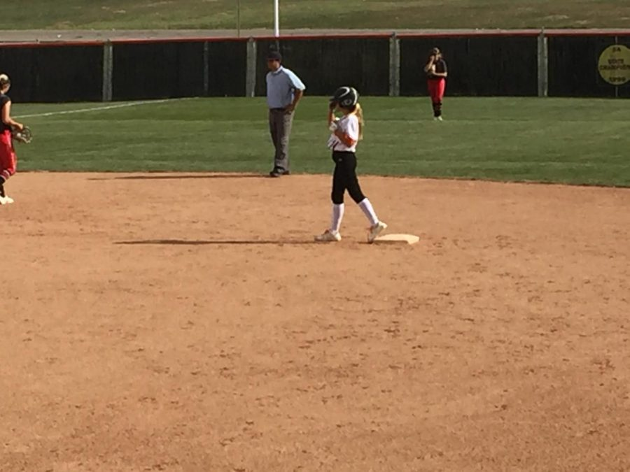 Freshman courtesy runner Lily Meskers stands on second base.