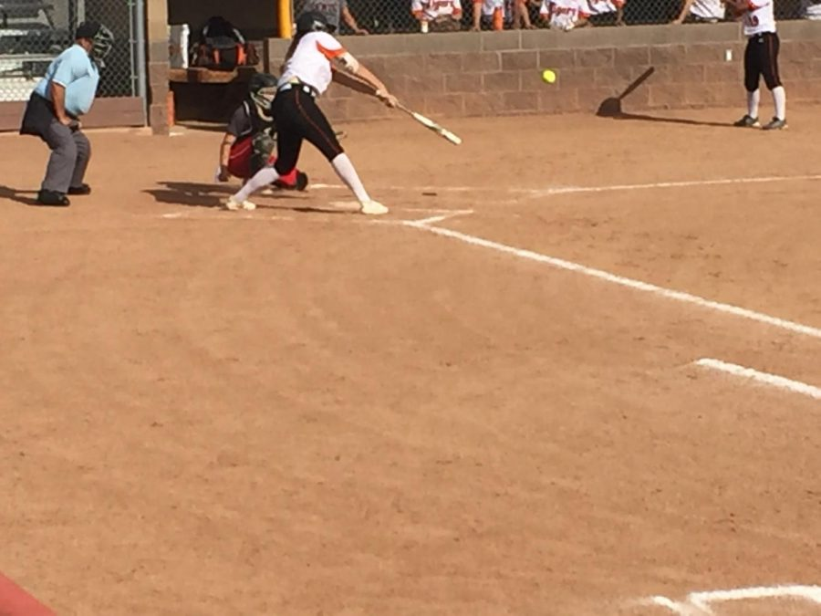 Kat Sackett smashes a double to left center field