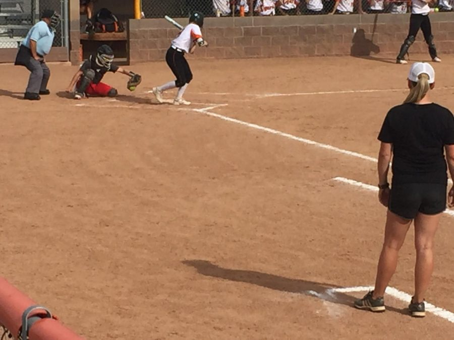 Teagan Brand watches a ball miss low and inside