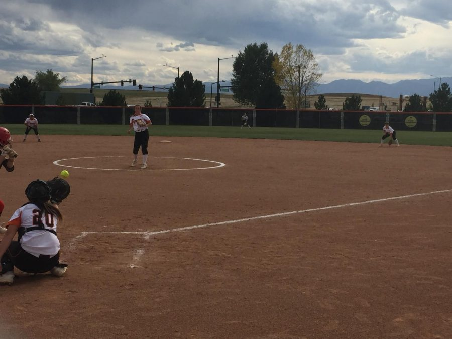 The Mustang hitter watches a strike go into Kat Sackett's glove