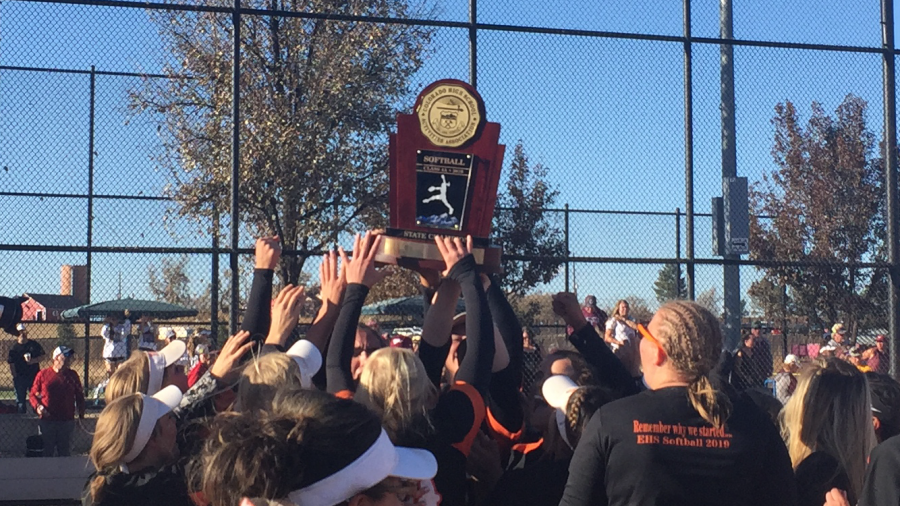 Erie softball hoists their state championship trophy after beating Golden 13-9