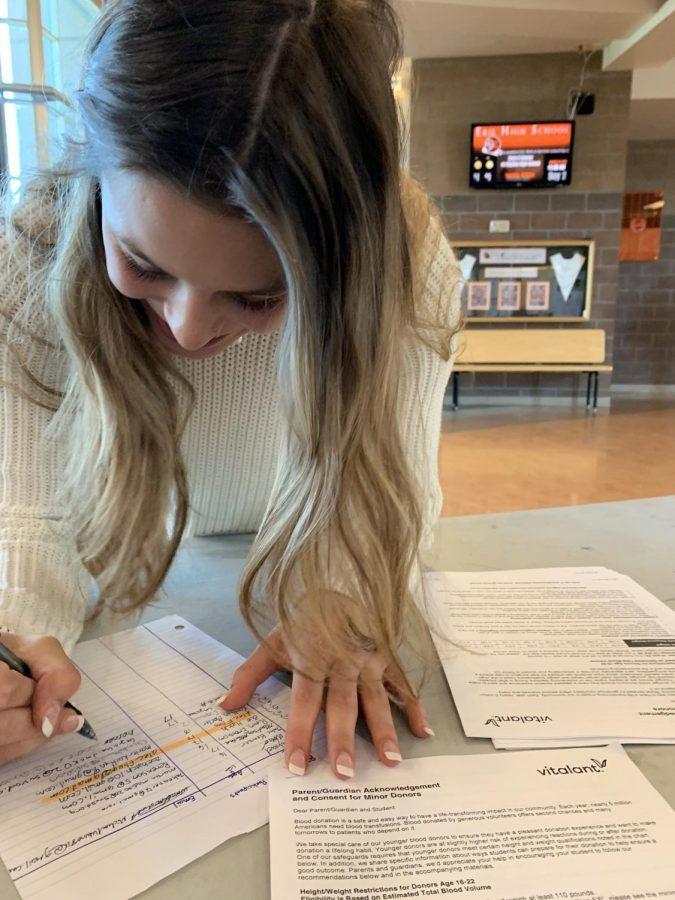 Sadie Horner a senior at Erie High School signing up for the blood drive.