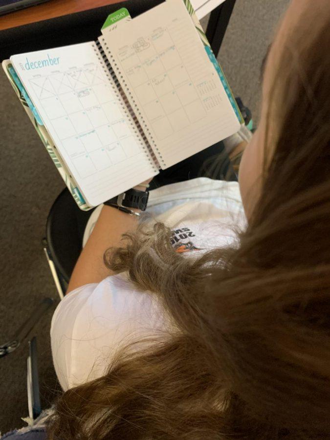 Emma Osborn writing in homework due later this week.