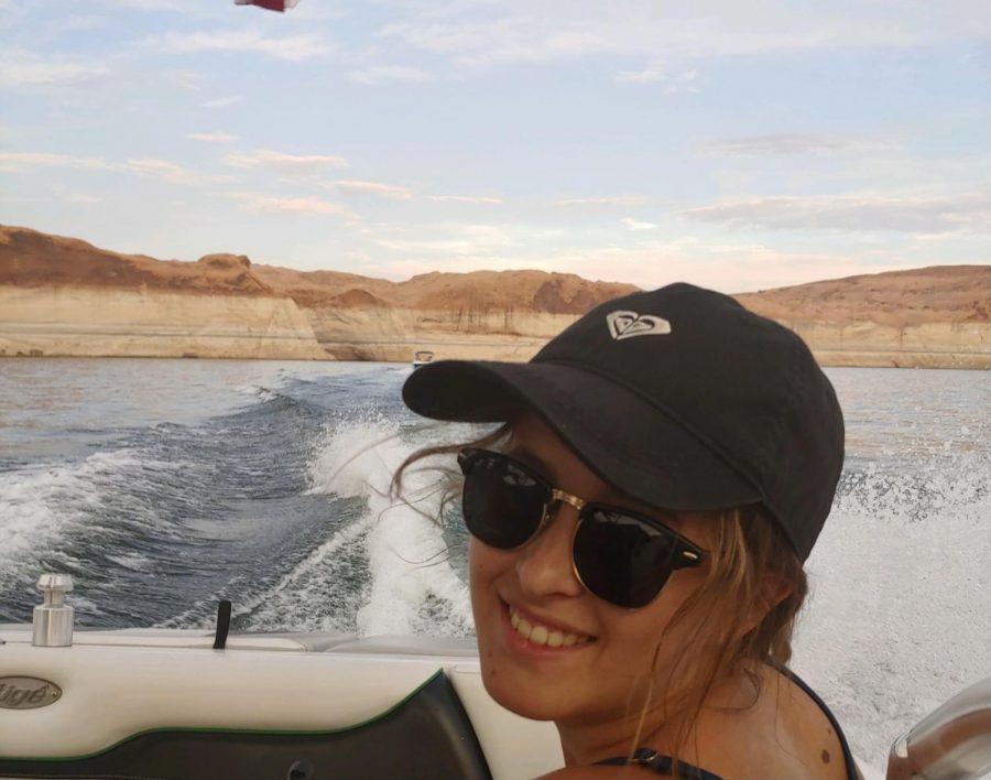 Hannah enjoys a nice day out on the lake as she drives her billion dollar yacht